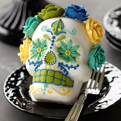 Flowers are thought to attract souls on this ritual holiday, Day of the Dead, celebrated Oct. 31 through Nov. 2. Buttercream roses in five shades crown a stand-up skull mini cake baked in Wilton's Dimensions 3-D Mini Skull Pan. skulls, skull cupcakes, cupcakes mexico, muertossugar skull, dead mini, dia de, skull cake, mini cakes, halloween