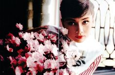Audrey Hepburn radiant with roses