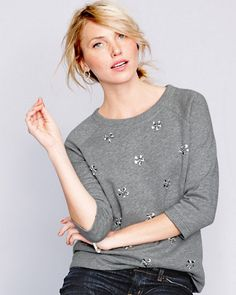 """""""A sweatshirt isn't just for lounging anymore. It's the new everyday staple, especially with a touch of crystal embellishment. I like to wear it with a dressier skirt or my favorite jeans for a girly-tomboy look. Choose one with cropped arms for an even cooler 1960's shape."""" - Anne Keane, Lucky Magazine"""
