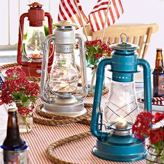 Spray paint old lanterns to create a patriotic centerpiece! More easy 4th of July decorations: http://www.bhg.com/holidays/july-4th/decorating/easy-diy-decorations-for-the-4th-of-july/?socsrc=bhgpin061613lanterns=7