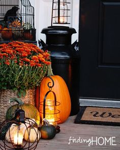 Fall front door vignette centered around lanterns
