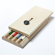This stationery case by designers Tomáš Král and Camille Blin clamps four pencils between its jaws.