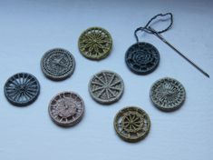 make your own buttons. buttons on 20mm brass rings and silk embroidery thread