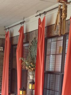 Curtain rod is a cut-to-size steel conduit purcased from local hardware short and hung from ceiling with shoestrings.  Very simple and easy to do.
