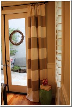 Wide horizontal striped drapery - cream panels with brown fabric stitched over it--These will be made and installed in my house!