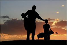 Love the photo silhouette of Dad & son each with their own bag of clubs on golf course.
