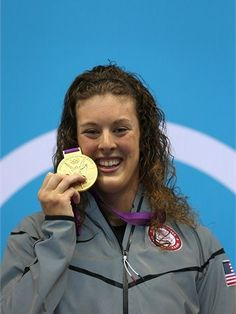 Gold medallist Allison Schmitt of the United States poses on the podium during the Victory Ceremony for the women's 200m Freestyle final on Day 4 of the London 2012 Olympic Games