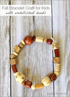 Kids will love embellishing their own beads for this fall bracelet craft! (Makes a great homemade gift for kids to make for the holidays too!)~BuggyandBuddy.com