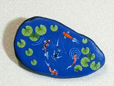 koi pond painted on a rock for a mini fairy garden