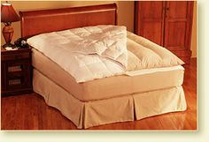 Down On Top Feather Bed Cover from Pacific Coast Feather Company - Simply the greatest feather bed cover, adding an additional layer of soft, lofty down for added dreaminess as well as protecting your feather bed.