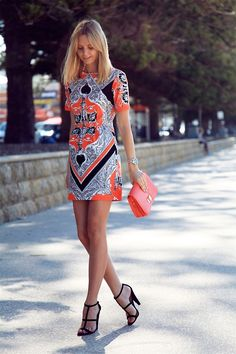 Colored Prints, Coral Clutch, Black Sandals and a great smile!! Love Summer!!!