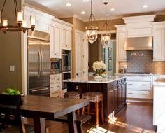 white cabinets, dark island, subway tile, hardwood floor