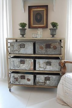 Rejuvenation Industrial: industrial salvaged storage boxes combined with more traditional elements. Somehow this works!