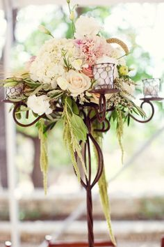 flower arrangement in a candelabra
