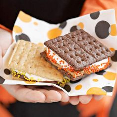 Spooky S'mores are party-ready! Find more easy treats here: http://www.bhg.com/halloween/recipes/quick-halloween-party-food/?socsrc=bhgpin091614spookysmores&page=9