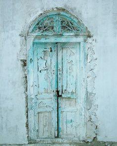 faded peeling paint turquoise door