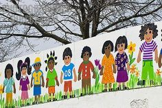 whimsical cartoon paintings of children on a white wall stock photo