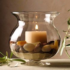 Bojo de vidro. Incluso vela aromárica, areia e pedras. Produto criado pela Pomeroy Home - Houston / Texas. Castiçal, candeeiro com um só foco luminoso,