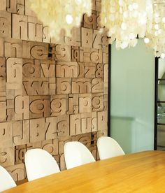 'Typology' is one of many intriguing wallpaper designs from Wall & Deco's 2010 'Life' Collection.  The pattern seems to be three-dimensional, an optical illusion that gives the impression that the wall consists of type blocks.  However, it's just vinyl wallpaper with a great graphic design.