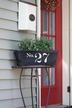 stencil or apply vinyl numbers to a planter box next to the front door