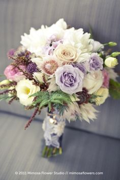 Pretty pastel shades in this beautiful #bridal bouquet look great with a variety of flowers, textures and interesting foliage.