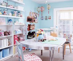 Full shot of craft room with pale blue walls and crocheted toys.