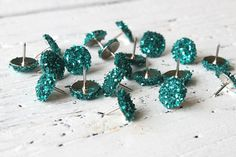 To buy or make for my bulletin board at work. Teal + sparkles + office supplies = 3 of my favorite things.