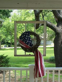Americana: old window frame and a waving flag