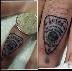 ouija planchette finger tattoo
