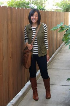 utility vest + stripes + black jeans + brown boots