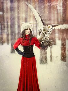 Untitled by Margarita Kareva on 500px   stunning winter scene with a lady in red holding an Owl.