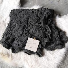 Beautiful lacy crocheted throw.