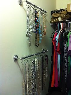 Exactly what I was looking for!! Jewelry Organization - hang necklaces and bracelets using towel bars and shower curtain hooks.
