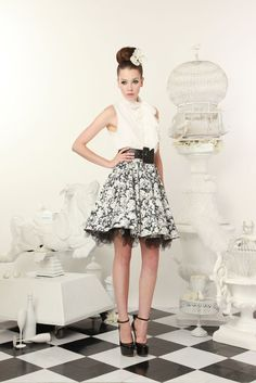 Bows, chiffon and crinoline. The only thing missing is the leather moto jacket!
