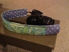 My DSLR camera strap complete with lens cap cover.