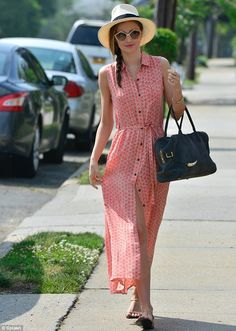 The thigh's the limit: Miranda Kerr flashes a hint of her slender thigh in a printed red and beige sleeveless button-up maxi dress as she heads to a photo shoot in Long Beach, New York on Thursday
