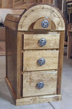 saddle rack with drawers! this is so awesome! you could store all kinds of tack in there, super handy! And it's nice enough to be in your house if you wanted it to be.