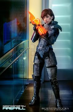 Big White Bazooka Photography and crystalcosfx's FemShep cosplay from Mass Effect. The smudge on her chek and the dents in her armor are a nice touch.