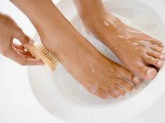 Fill a bucket with warm water and a cup of epsom salt. Once the salt has dissolved, place your feet inside of the water. Remove feet from water after 3o minutes. Scrub gently with toothbrush to remove all loose, dry skin. The skin should be very easy to remove. Rinse feet with water and pat dry with towel, need for summer!