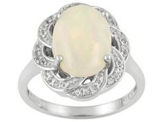 1.98ct Oval Cabochon Ethiopian Opal And .16ctw Round White Topaz Sterling Silver Ring