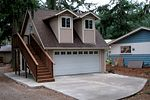 Tuff Shed - we could live over the garage while building a house and have that space available later to help others