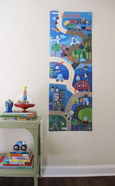 I want this for Jonah!  On Track - Personalized Canvas growth chart. $39.99, via Etsy.