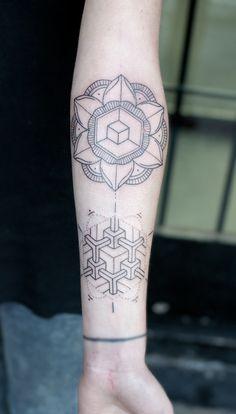black and grey geometric flower tattoo