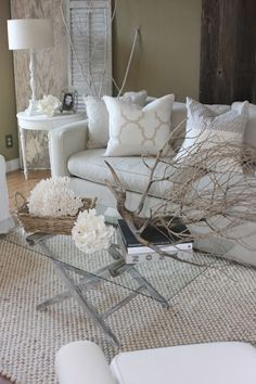 Beautiful neutral colours, great textures on carpet, vintage shutter and table display and plenty of light and shade, that's what makes great decor!