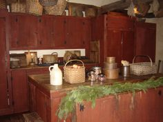 hubby built our cabinets and center island to hide all modern appliances to make a more primitive kitchen...the front piece is an old red chimney cupboard we bought from Judy Coffey's antique shop. He used milk paint and then distressed the wood to match the piece.