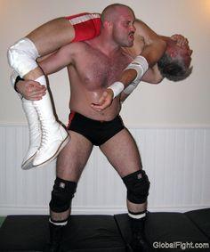 a pro wrestler man handling opponent