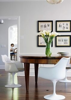 | EA |  Modern chairs with antique table.