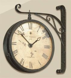hanging wall clock: DIY with that old vintage black plant hanger in the garage