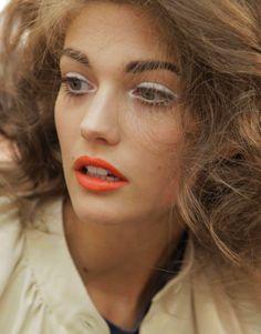 white eyeliner + red-orange lip