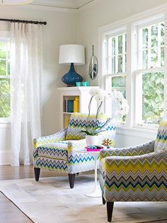 Brighten up your space with chevron fabric chairs. chair, living rooms, color palettes, white walls, lamp, bookcas, family rooms, window treatments, light